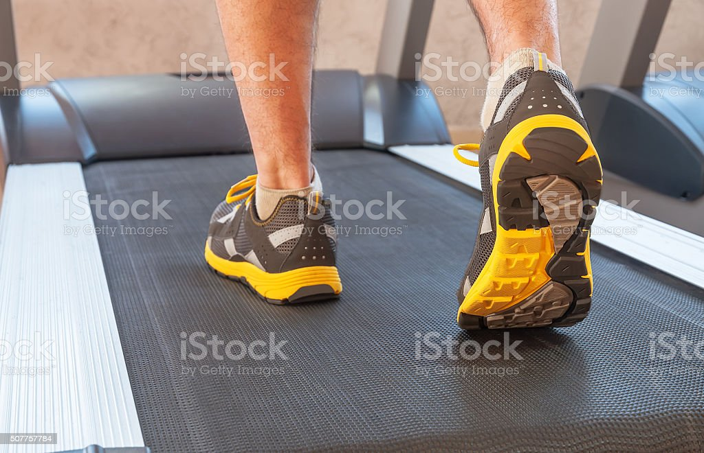 man in a gym on treadmill stock photo