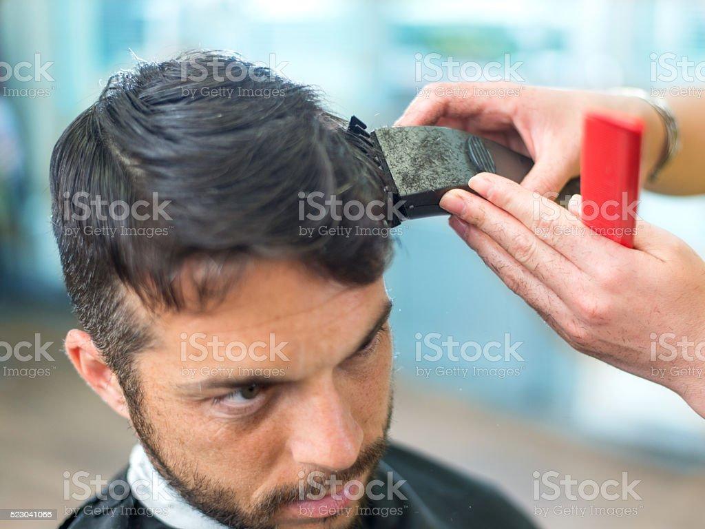 Man in a hair salon stock photo