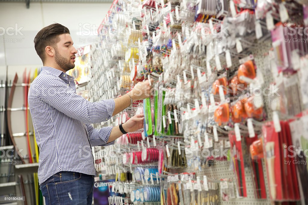 Man in a hardware store stock photo