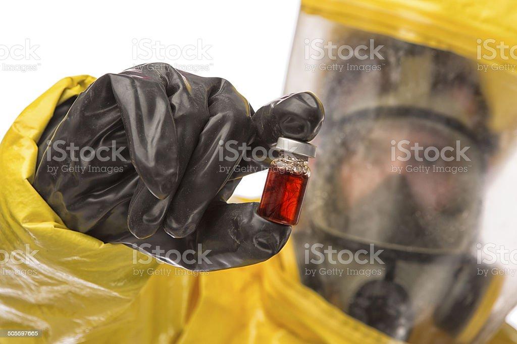 Man in a hazmat Suit holding vial stock photo