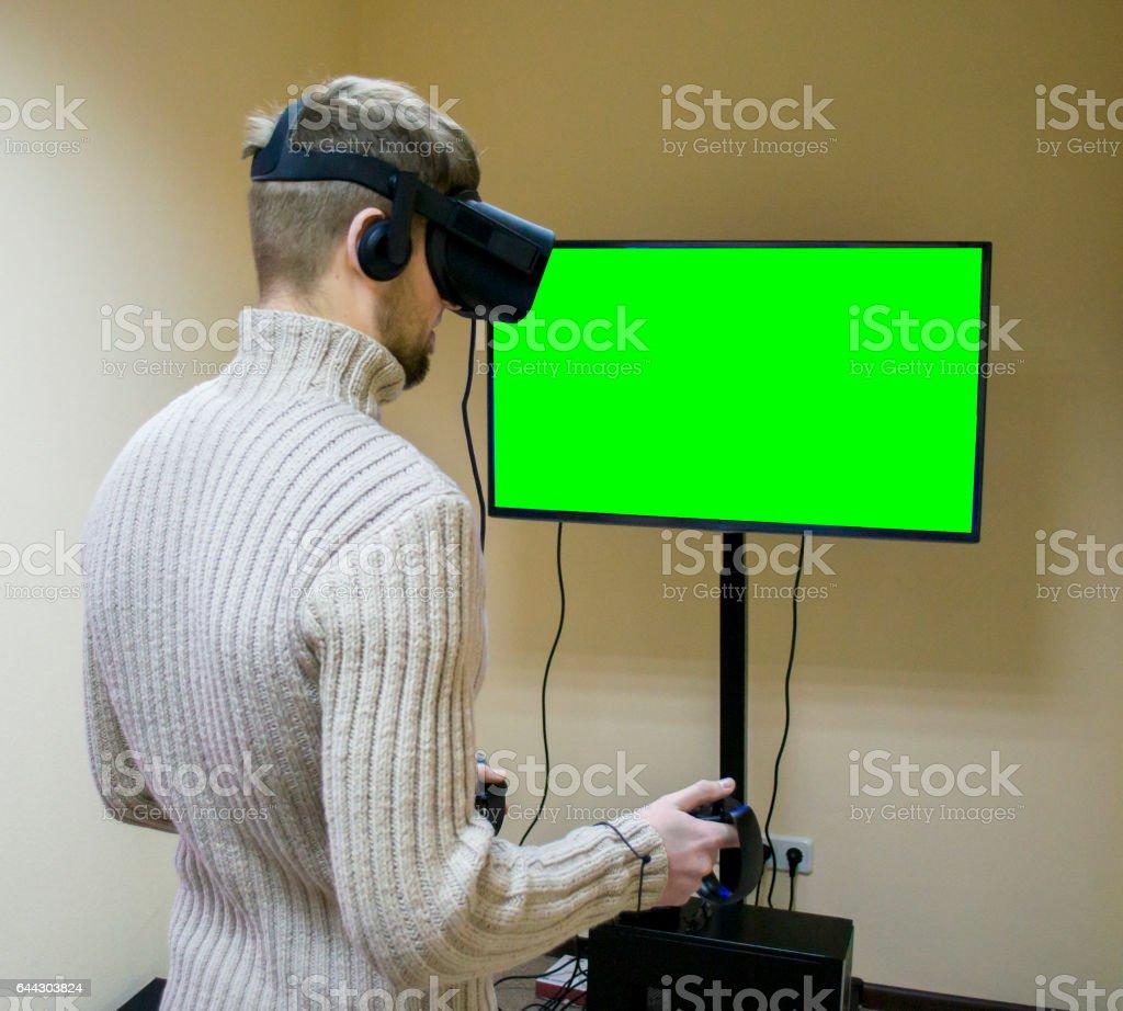 3d7de5d7fd5 Man In A Helmet Virtual Reality Plays A Game stock photo 644303824 ...