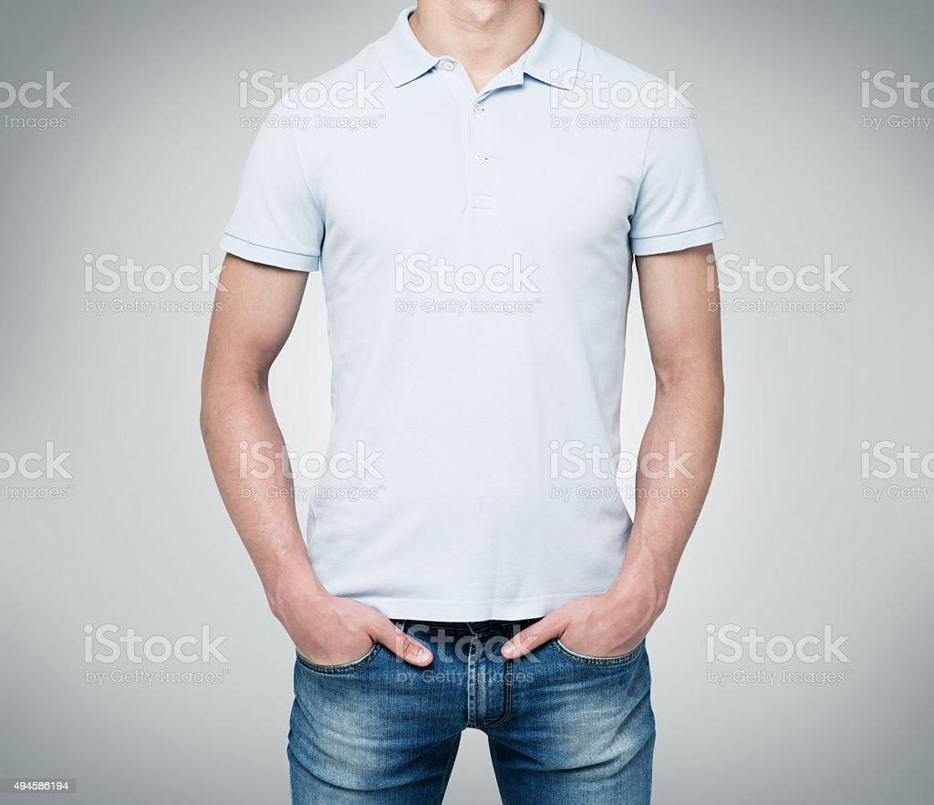 man in a light blue polo shirt stock photo