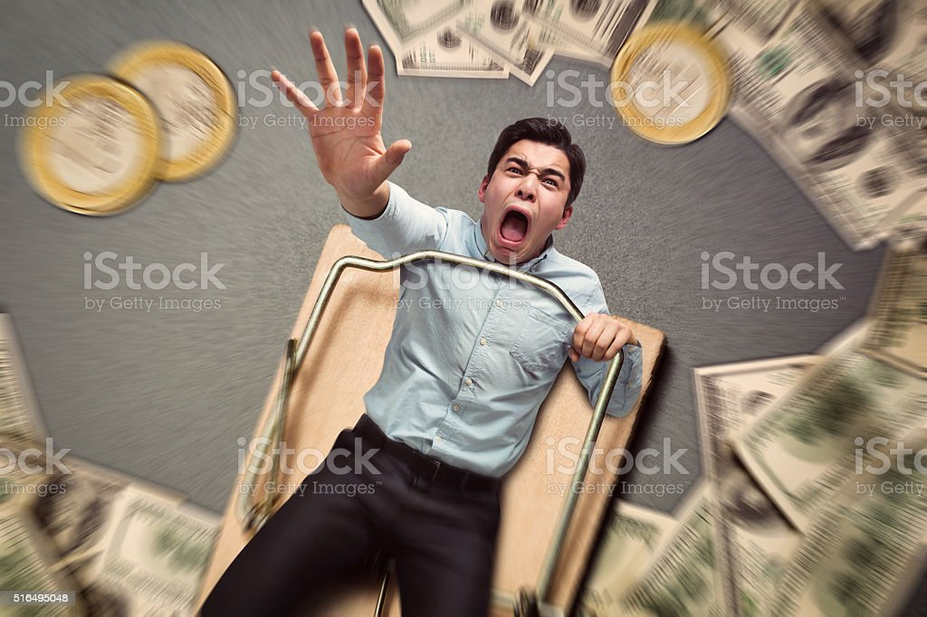 Man in a mouse trap falling stock photo