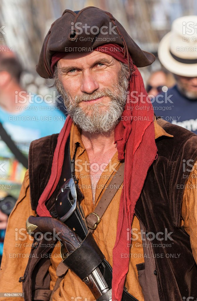 man in a pirate costume walks on the Hanse Sail stock photo