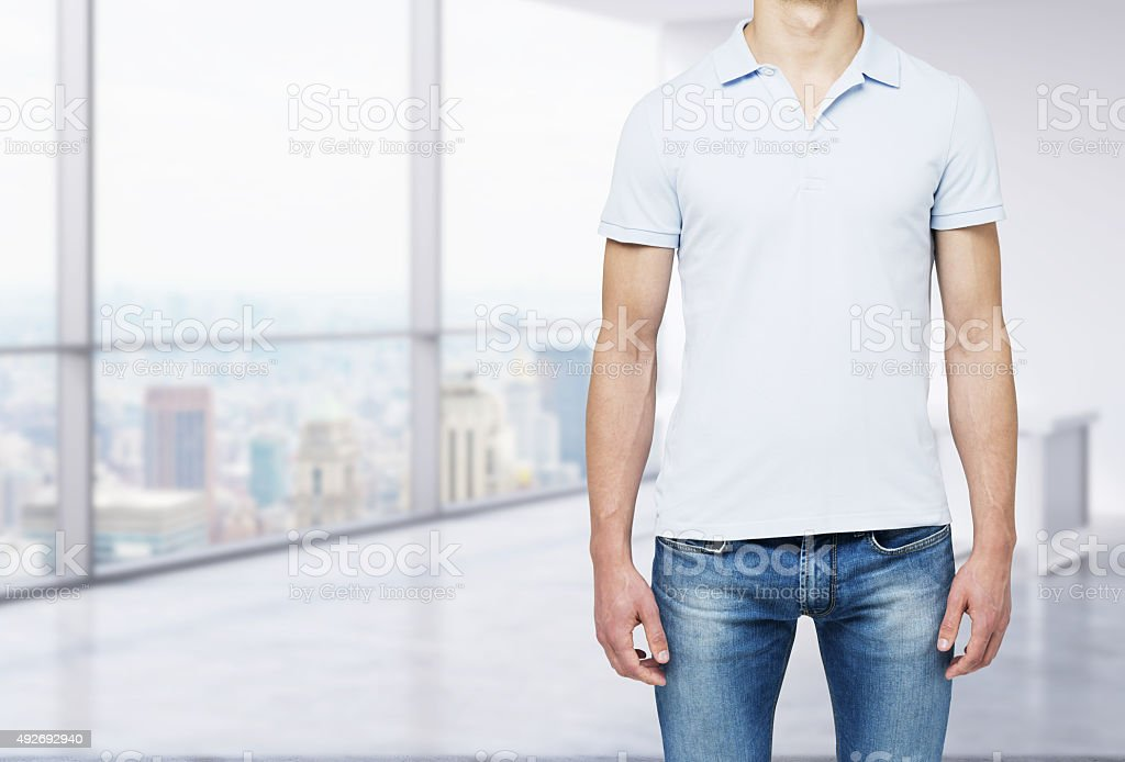 man in a polo shirt  in modern panoramic office stock photo