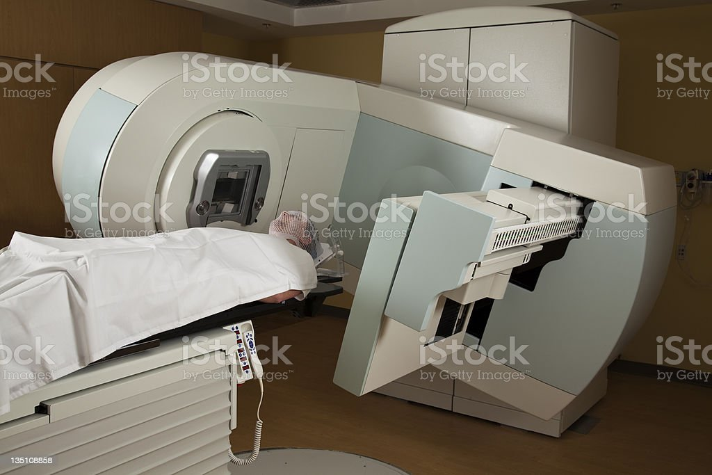 Man in a radiation machine receiving treatment for Cancer stock photo