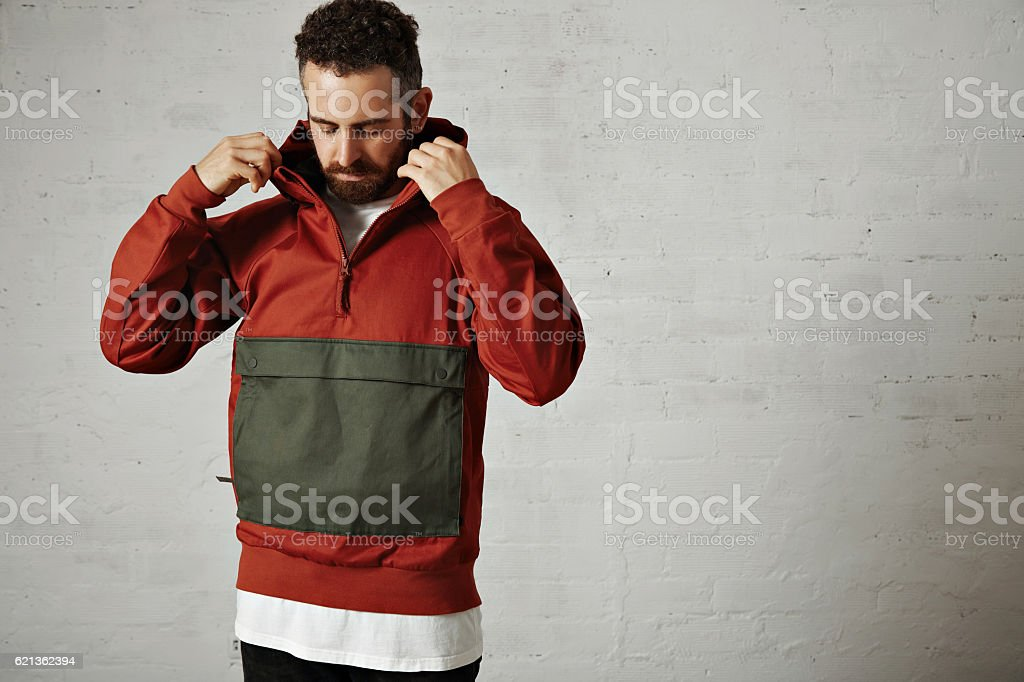 Man in a red anorak stock photo