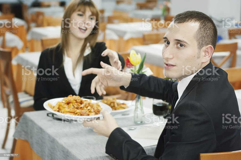 Man in a Restaurant Complining of the Pasta. stock photo