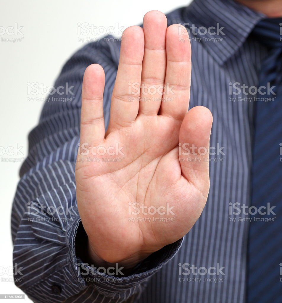 A man in a shirt holding his hand in a stop position royalty-free stock photo