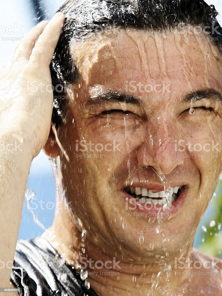 Man in a shower stock photo