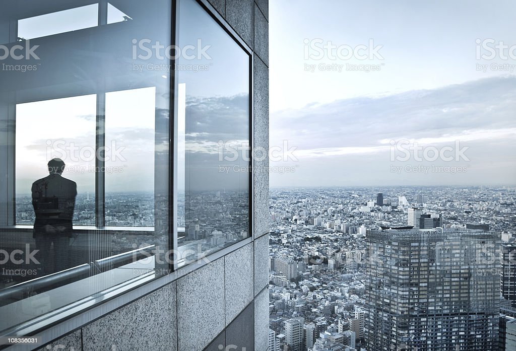 man in a skyscraper stock photo
