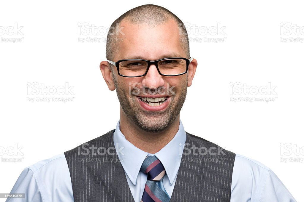 Man in a suit and tie with glasses on, smiling widely royalty-free stock photo