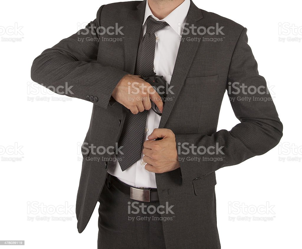 Man in a suit grabbing gun royalty-free stock photo