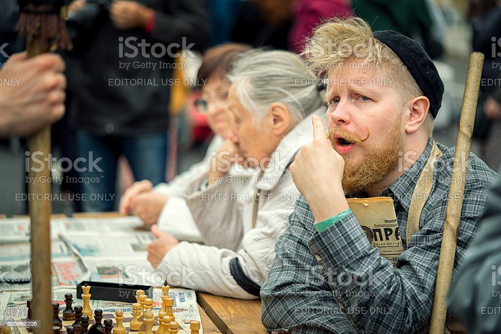 man in a suit janitor 60s playing of chess stock photo