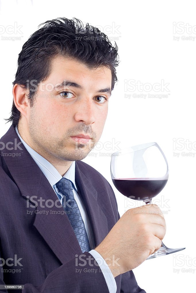 Man in a suit tasting wine royalty-free stock photo