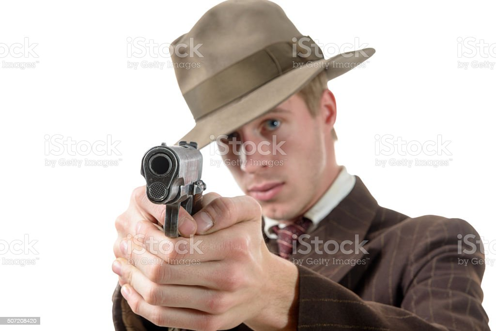 man in a suit vintage, aim with a gun stock photo