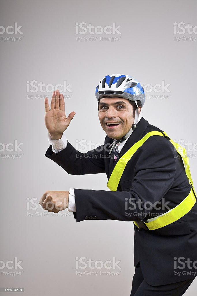 Man in a suit wearing reflective belt and helmet royalty-free stock photo