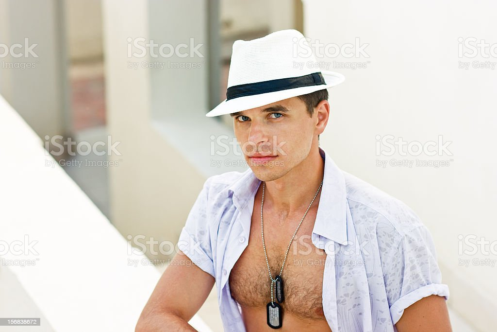 Man in a white hat stock photo
