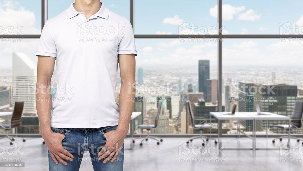 man in a white polo shirt stock photo