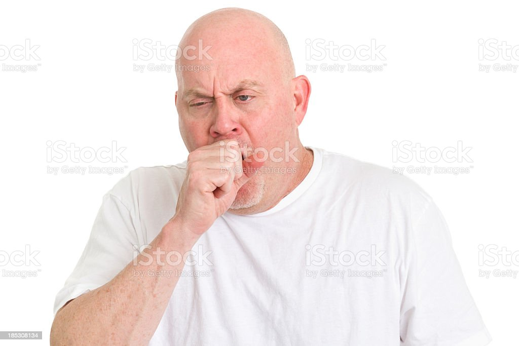 A man in a white shirt covering his mouth whist coughing stock photo