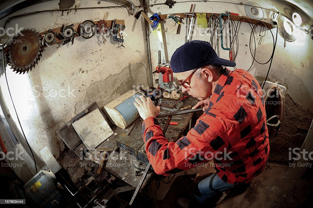 Man  in a workshop royalty-free stock photo