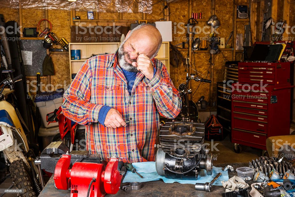 Man in a workshop with an eye injury stock photo
