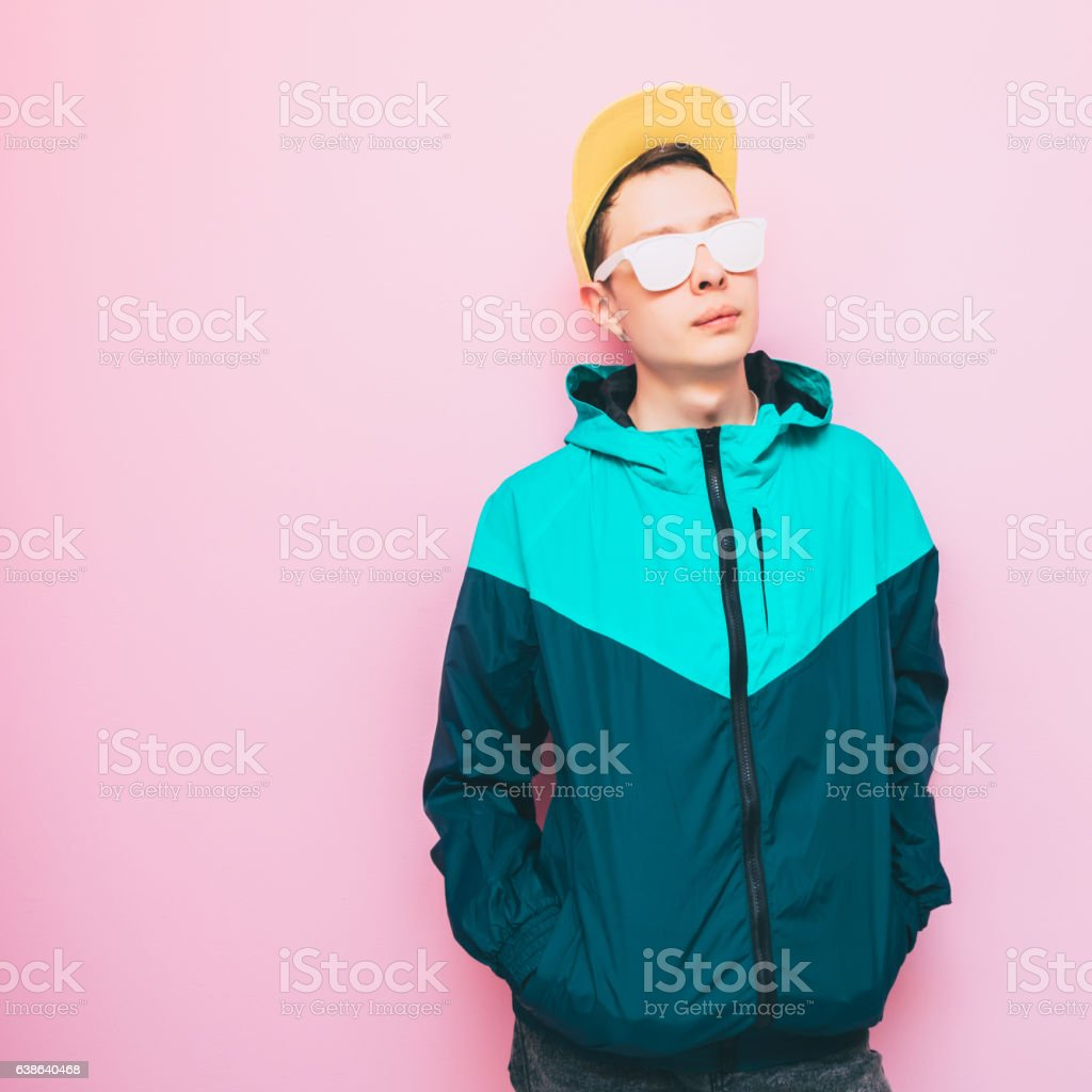 man in a yellow baseball cap stock photo