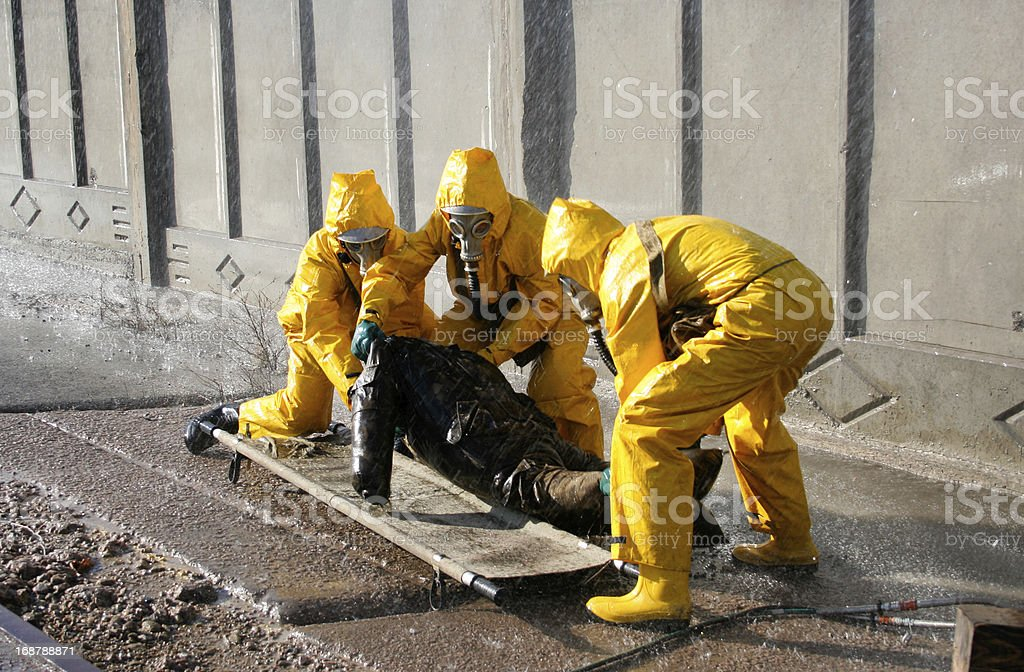 man in a yellow chemical protection suit stock photo