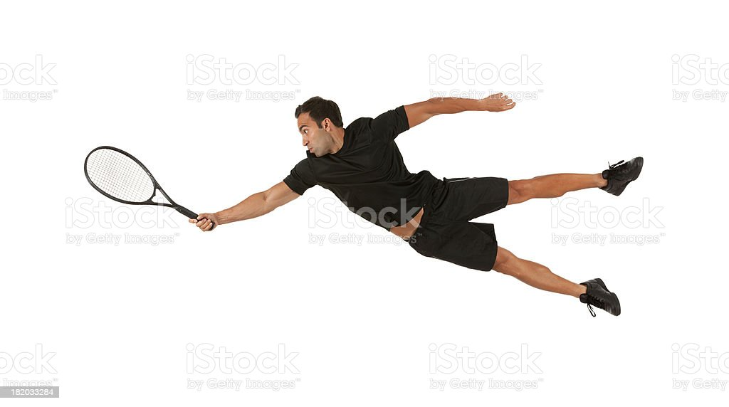 Man in action playing tennis royalty-free stock photo