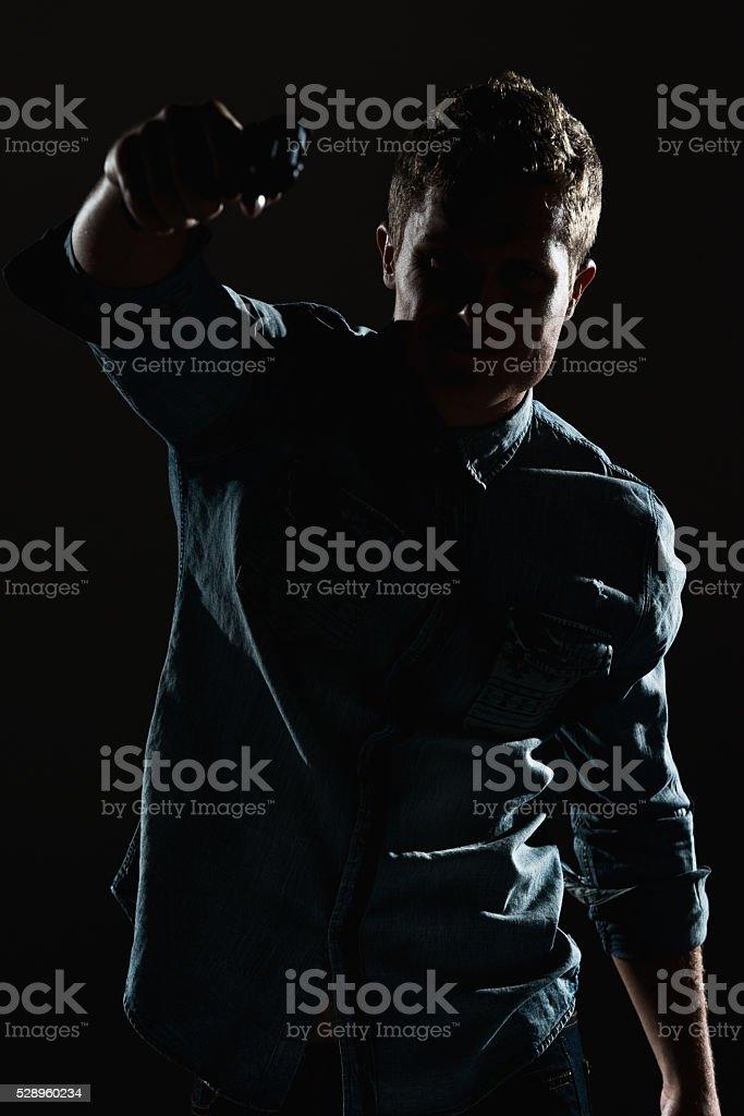 Man in action with handgun stock photo