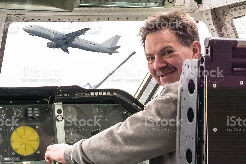 Man in aircraft cockpit. stock photo