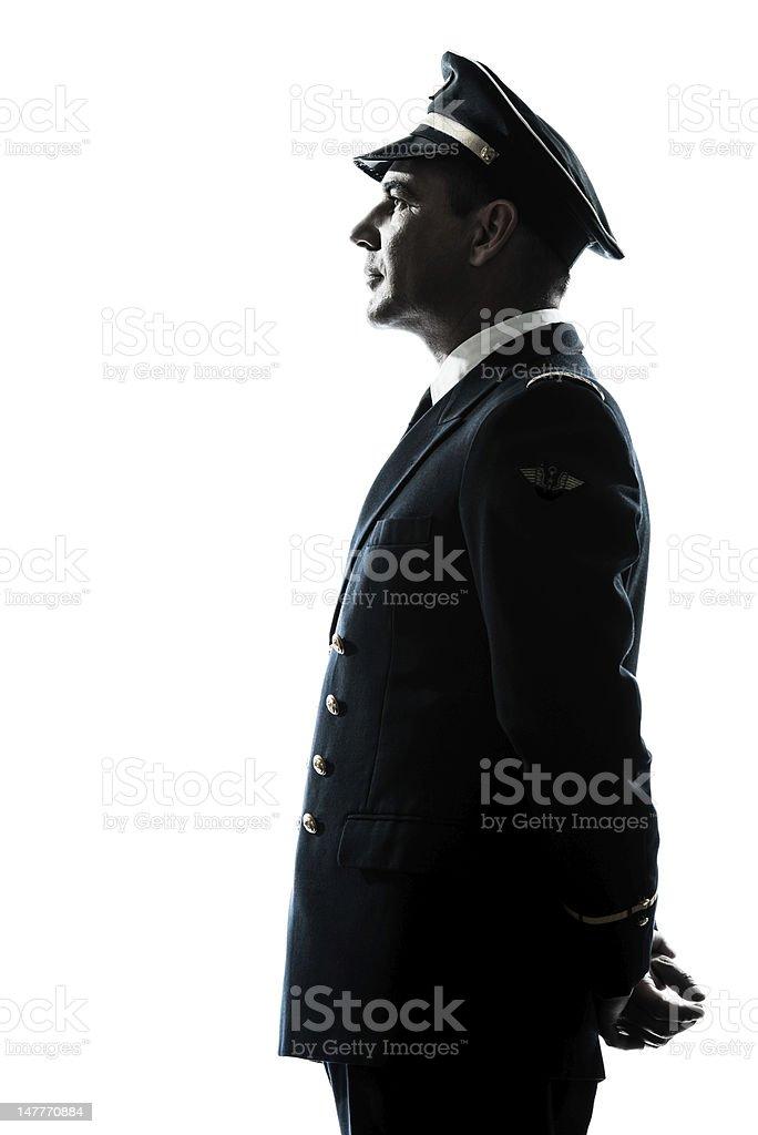 man in airline pilot uniform silhouette stock photo