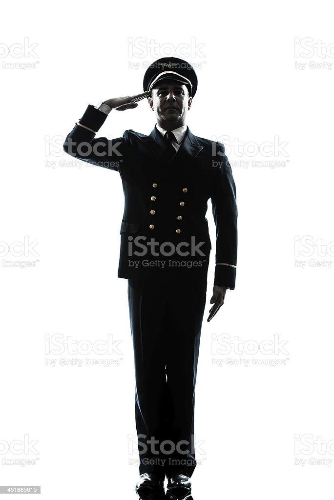 man in airline pilot uniform silhouette saluting stock photo