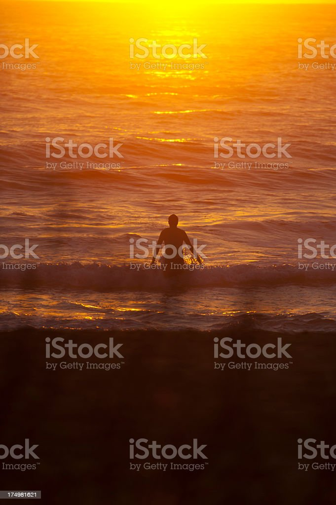Man in an inspirational sunrise ocean stock photo