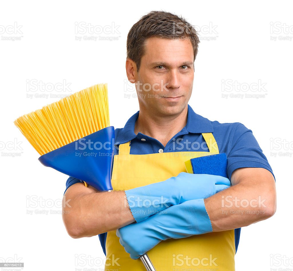 Man in apron with broom and sponge on white stock photo