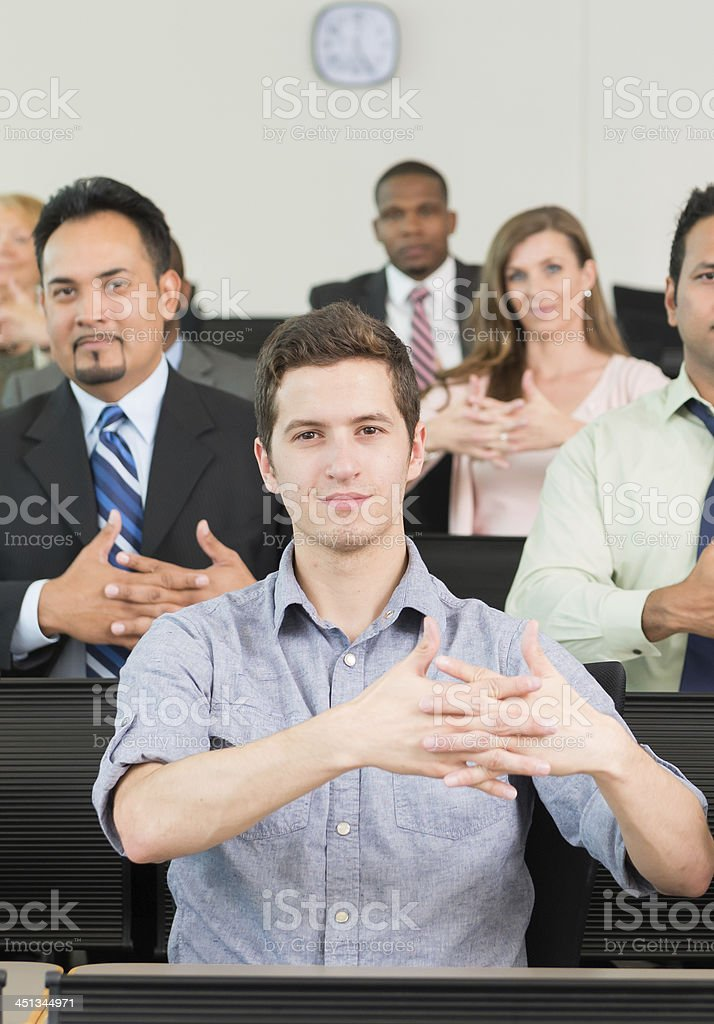 Man in ASL Class learning AMERICA stock photo