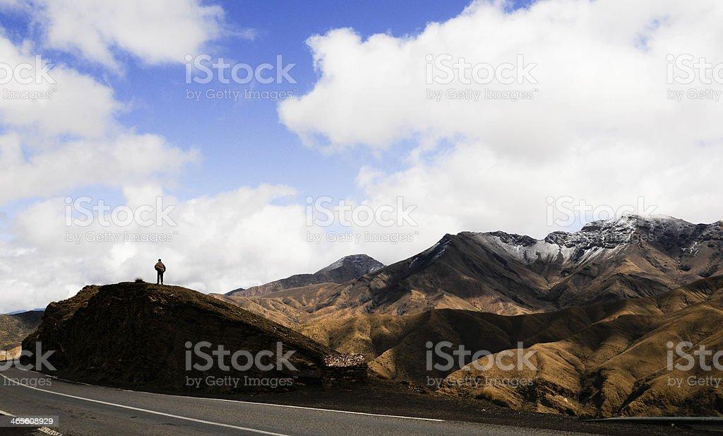 Man in Atlas Mountain, Morocco stock photo