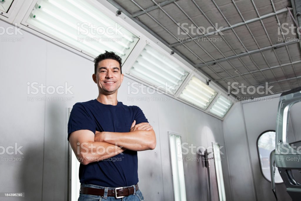 Man in auto body shop royalty-free stock photo