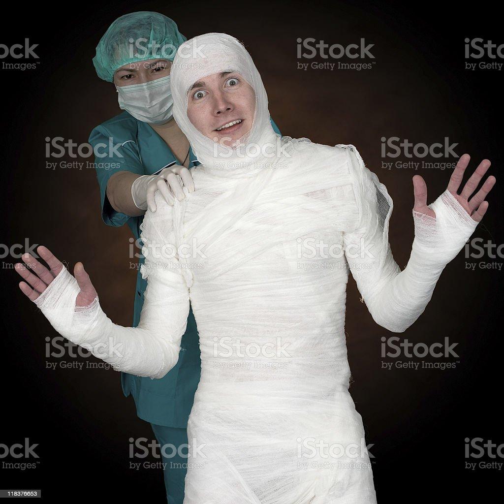 Man in bandage and nurse stock photo