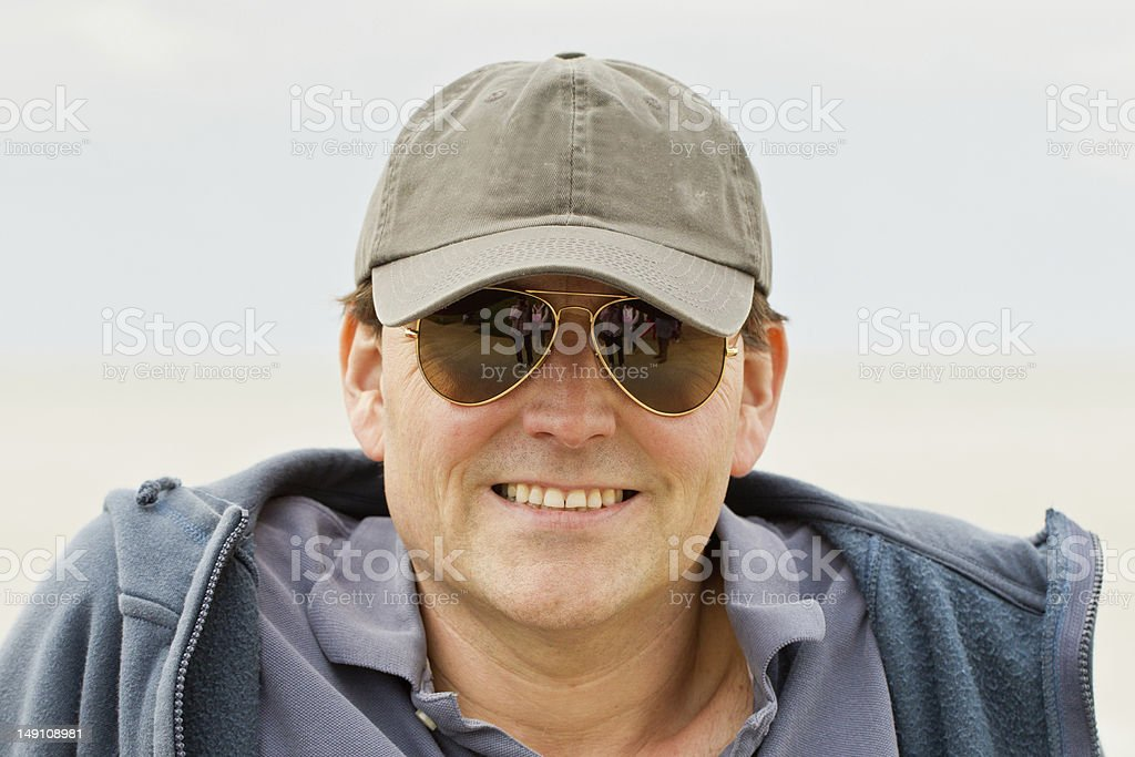 Man in baseball cap and sunglasses stock photo