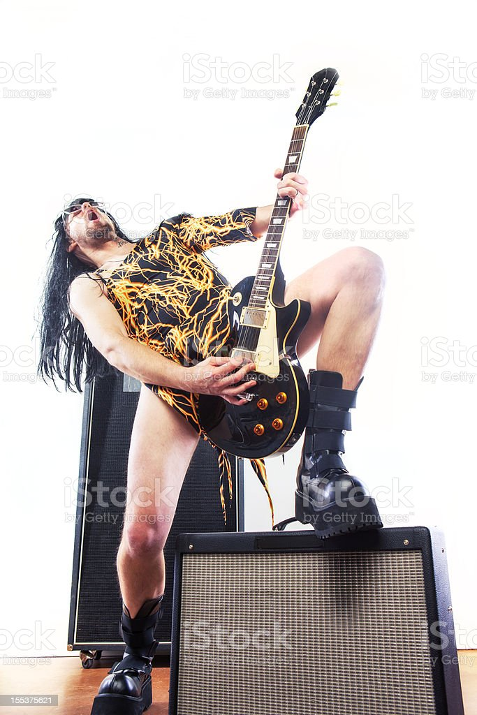 Man in Black and Yellow Leotard Rocks With Guitar, Boots stock photo