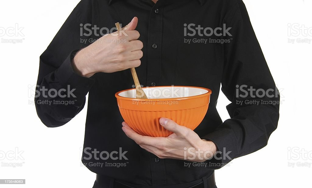Man in Black Holds Bowl royalty-free stock photo