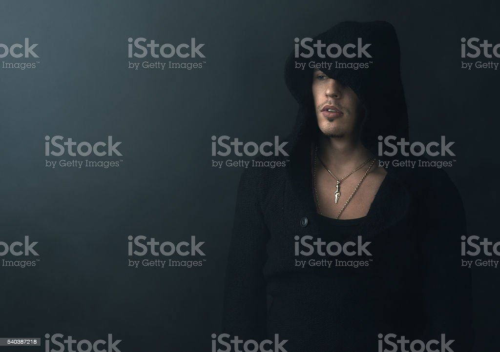 man in  black hoodie upset stock photo