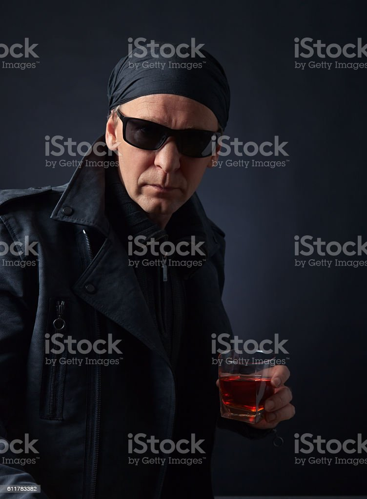 man in black jacket stock photo