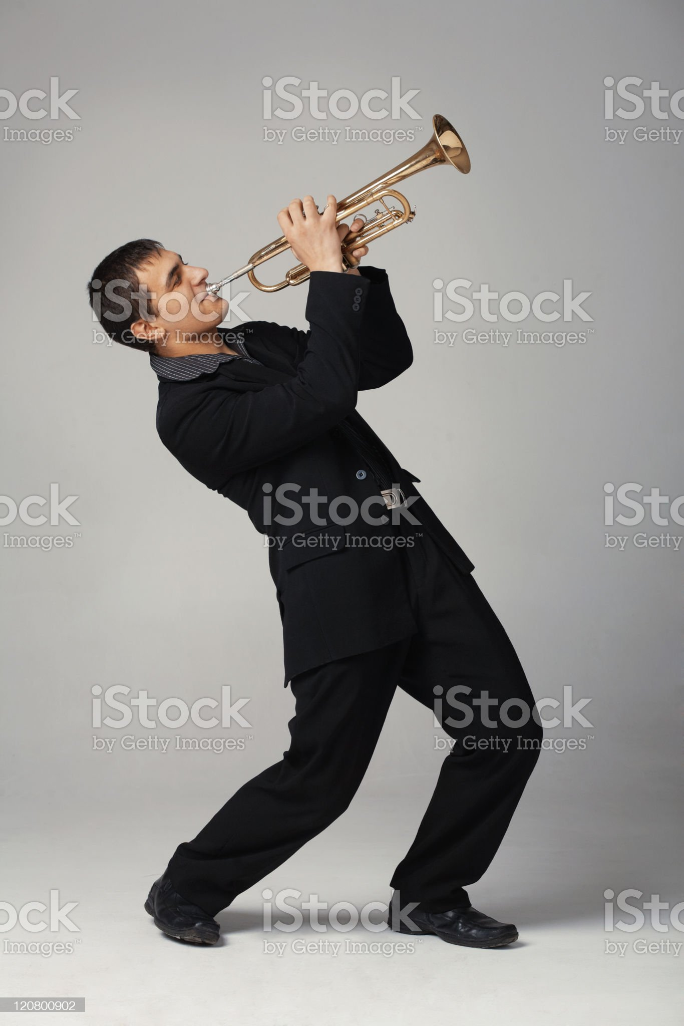 Man in black playing the trumpet royalty-free stock photo