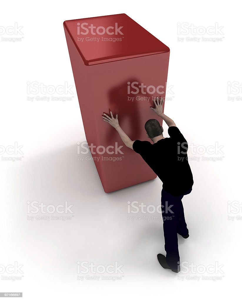 Man in black pushing a red block royalty-free stock photo