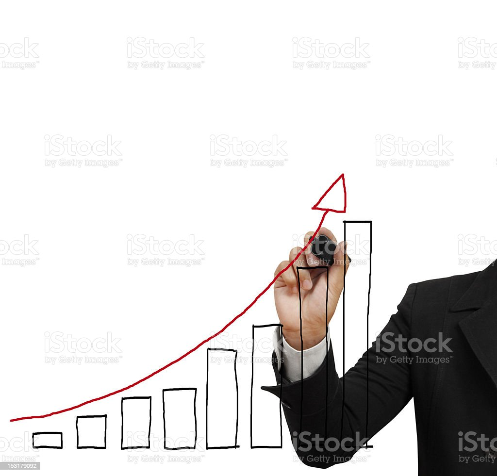 Man in black suit draws a bar graph with red arrow climbing stock photo
