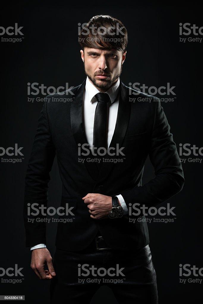 Man in black tuxedo stock photo