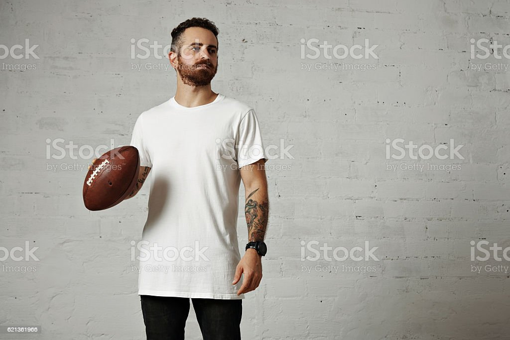 Man in blank white t-shirt with a vintage football stock photo