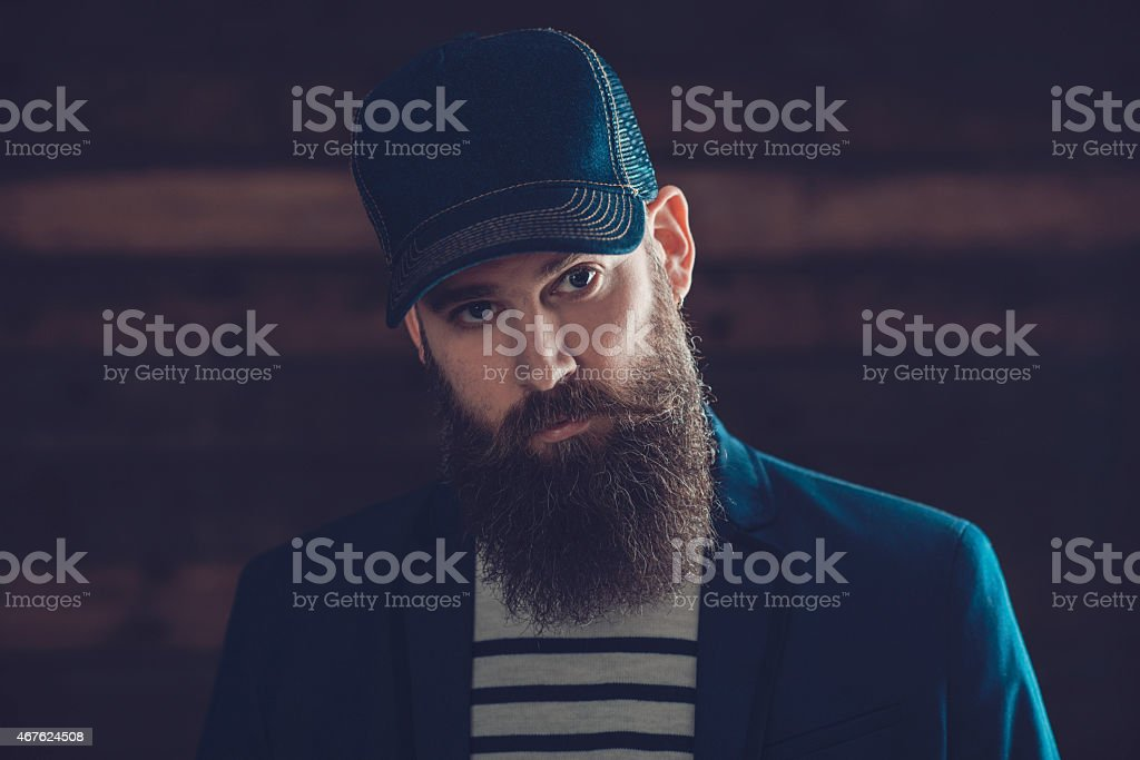 Man in Blue Cap with Long Beard and Mustache stock photo